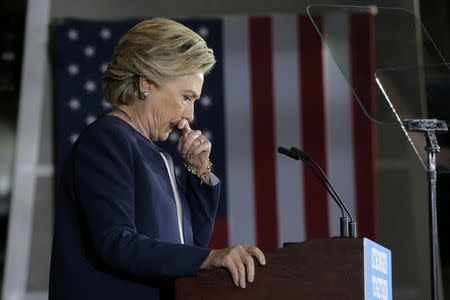 Democratic U.S. presidential nominee Clinton pauses while speaking at campaign rally at Heinz Field in Pittsburgh