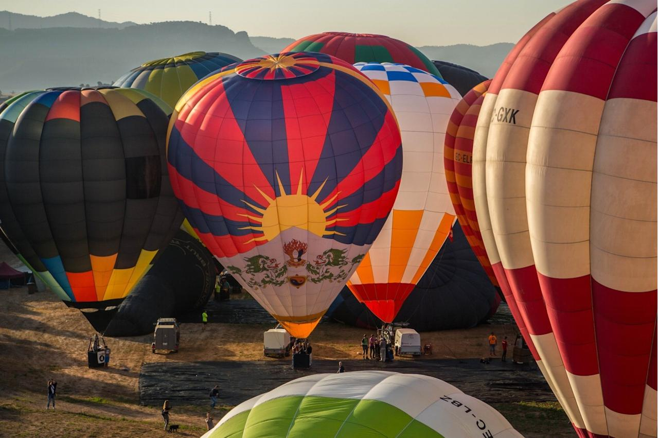 <p>Hot air balloons are inflated at the European Balloon Festival on July 7, 2016 in Igualada, Spain. (David Ramos/Getty Images) </p>