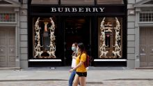 Britain's Burberry turns younger, urban heads to salvage sales