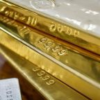 Gold inches lower as dollar holds firm on U.S. tax bill hopes