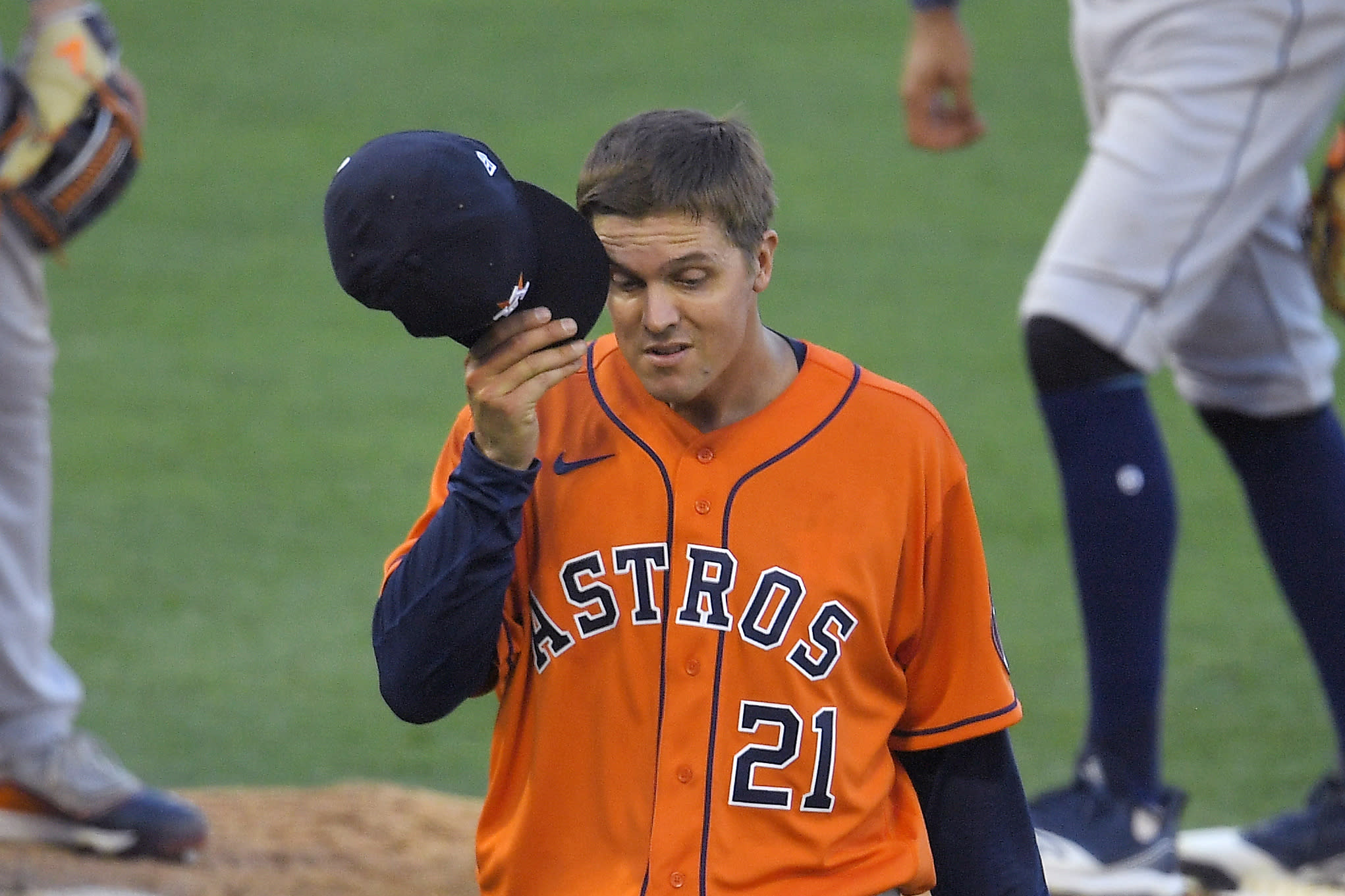 Houston Astros' Zack Greinke rubs his face as he is taken out of a baseball game during the seventh inning against the Los Angeles Angels, Saturday, Aug. 1, 2020, in Anaheim, Calif. (AP Photo/Mark J. Terrill)