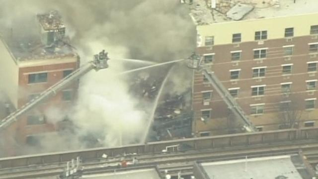 Firefighters respond to reports of New York building collapse