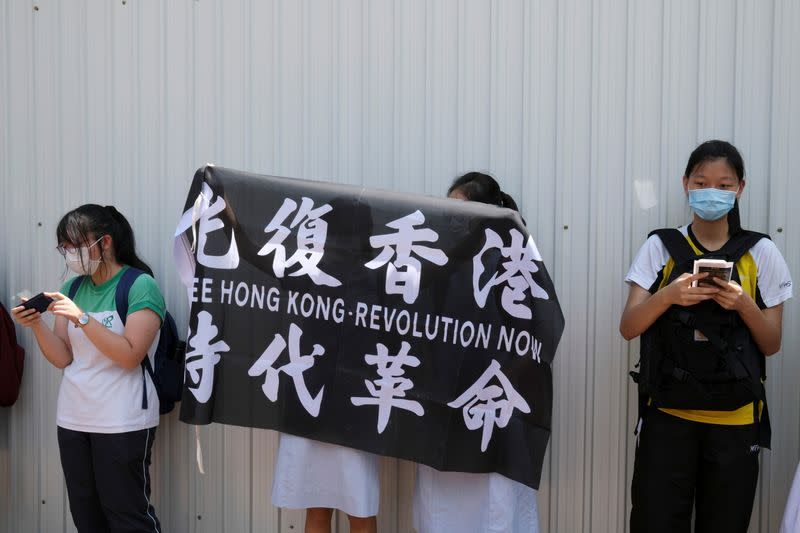 Hong Kong bans protest anthem in schools as fears over freedoms intensify