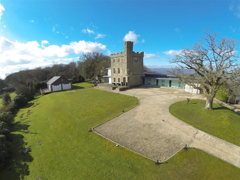 <p>In fifth place is the first of two mega-expensive homes on the list - and by far the most unusual. This one, in Newport, south Wales, hit the market in February for £1,899 950.</p>  <p>The 1720s hunting lodge and tower had been transformed during an episode of Grand Designs in 2009 - by a couple who added a dramatic glass extension. Thousands of us couldn't resist having a look around.</p>