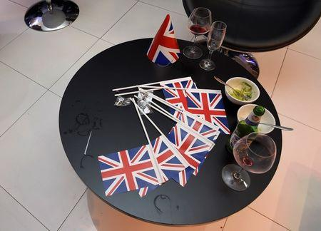 Half-finished drinks and Union flags lie on a table at a A Leave.eu party after polling stations closed in the Referendum on the European Union in London