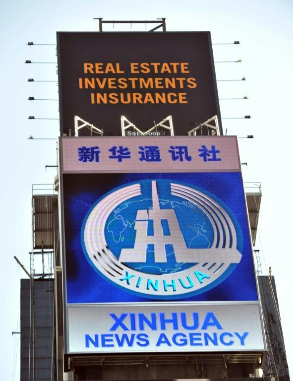 An electronic billboard in 2011 promotes Xinhua, the news agency operated by the Chinese government, in New York's Times Square (AFP Photo/STAN HONDA)