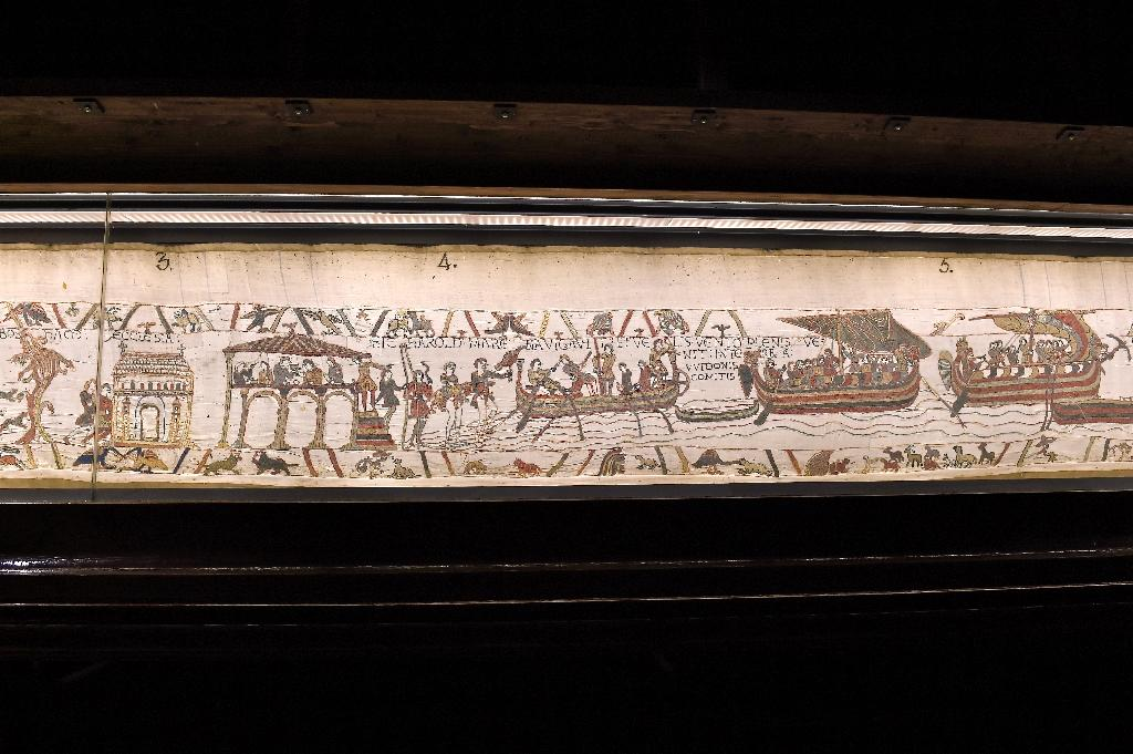 A portion of the historic Bayeux Tapestry which Theresa May said would be returning to Britain in 2022 for the first time in 900 years (AFP Photo/Stephane MAURICE)