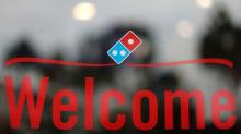 UK's Domino's shares rise on buyback, organic sales rise