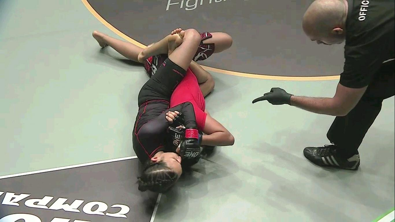 Singapore female MMA star Kirstie Gannaway chokes out ...