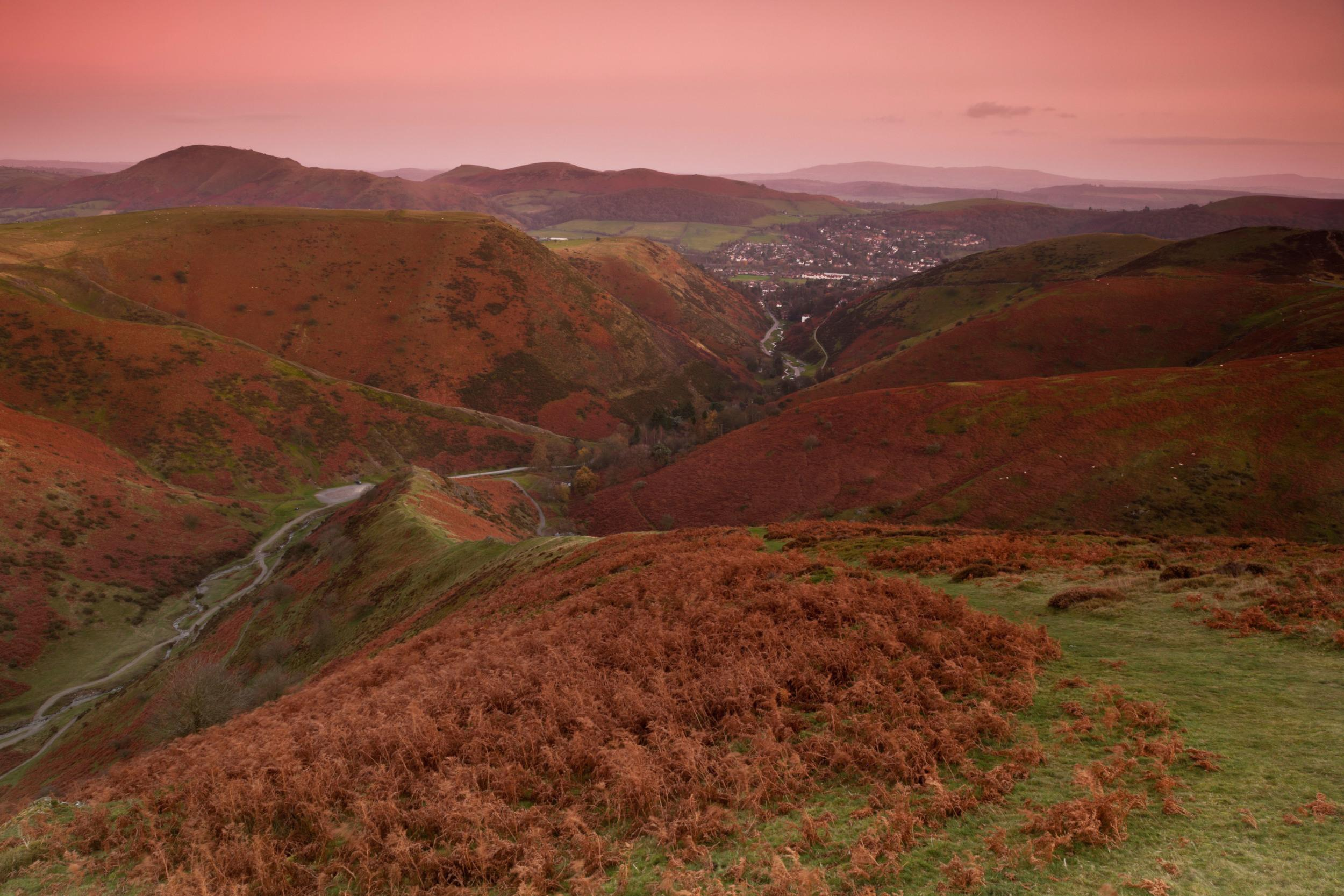 """At this time of year, if you take<a href=""""http://www.nationaltrust.org.uk/cardingautumnwalk"""" style=""""font-size:14.4444446563721px;"""" target=""""_blank"""">the Pipe Walk at Carding Mill Valley</a>you'll be amazed by the blues, golds and greens.<span style=""""font-size:14.4444446563721px;"""">Emily Knight, Conservation Manager at Carding Mill, says: """"For a lot of visitors, the view and colours at Carding Mill are a surprise. As they come out of Church Stretton they cross a cattle grid and suddenly these incredible hills are in front of them.""""</span>"""
