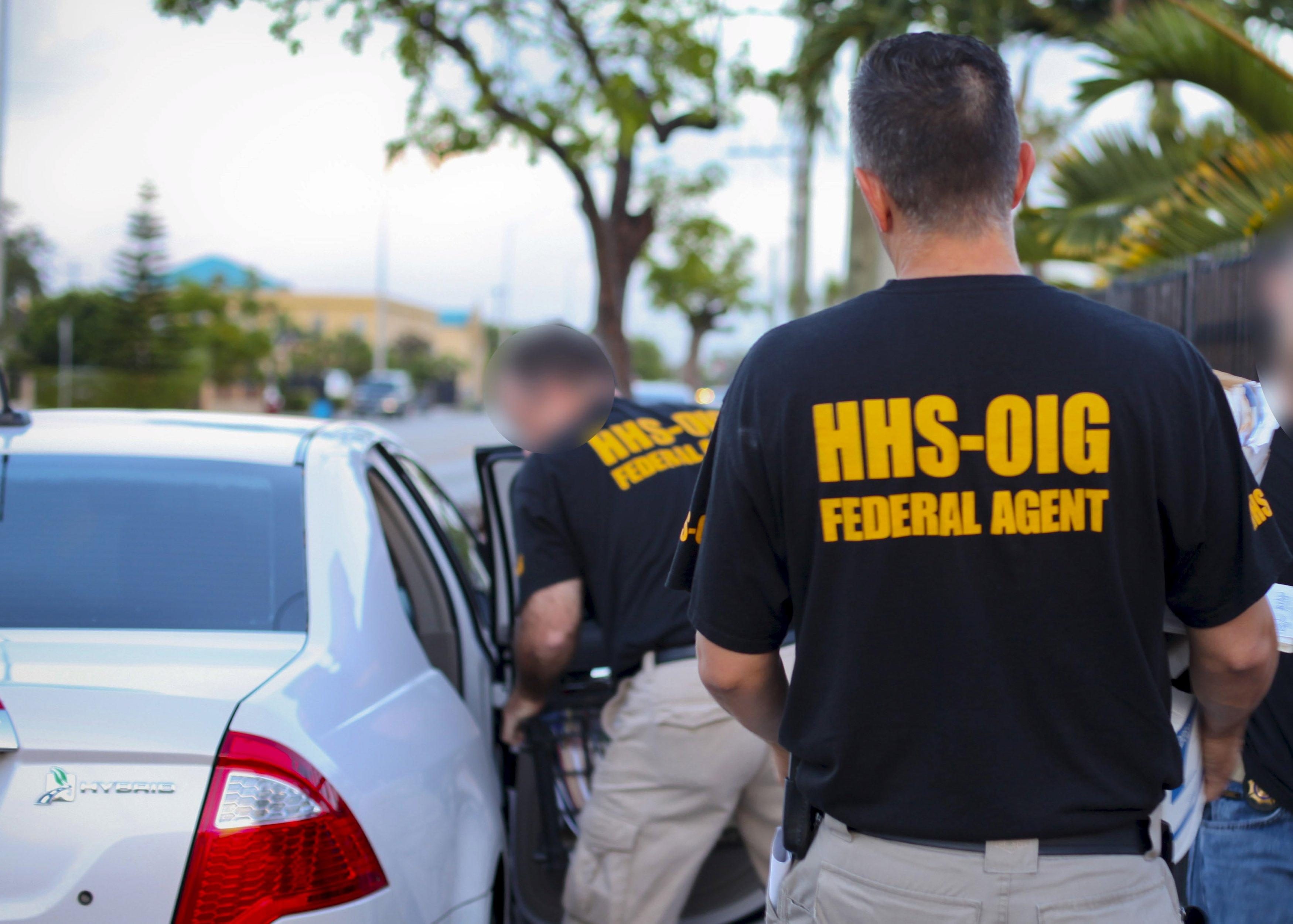 Agents from the U.S. Department of Health and Human Services (HHS) Office of the Inspector General are pictured loading evidence, in this undated photograph provided on April 28, 2015. The HHS Office of the Inspector General investigates fraud, waste and abuse in Medicare. Picture digitally masked at source. To match Special Report USA-MEDICAID/FRAUD REUTERS/U.S. Department of Health and Human Services Office of the Inspector General/Handout via Reuters ATTENTION EDITORS - THIS PICTURE WAS PROVIDED BY A THIRD PARTY. REUTERS IS UNABLE TO INDEPENDENTLY VERIFY THE AUTHENTICITY, CONTENT, LOCATION OR DATE OF THIS IMAGE. FOR EDITORIAL USE ONLY. NOT FOR SALE FOR MARKETING OR ADVERTISING CAMPAIGNS. THIS PICTURE IS DISTRIBUTED EXACTLY AS RECEIVED BY REUTERS, AS A SERVICE TO CLIENTS. PICTURE DIGITALLY ALTERED AT SOURCE.