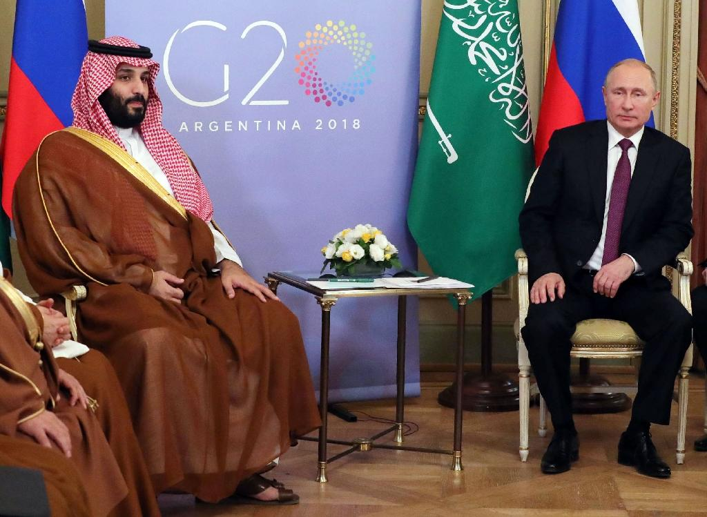 Russia's President Vladimir Putin (R) said he and Crown Prince Mohammed bin Salman 'have agreed to extend our agreement' to limit oil output