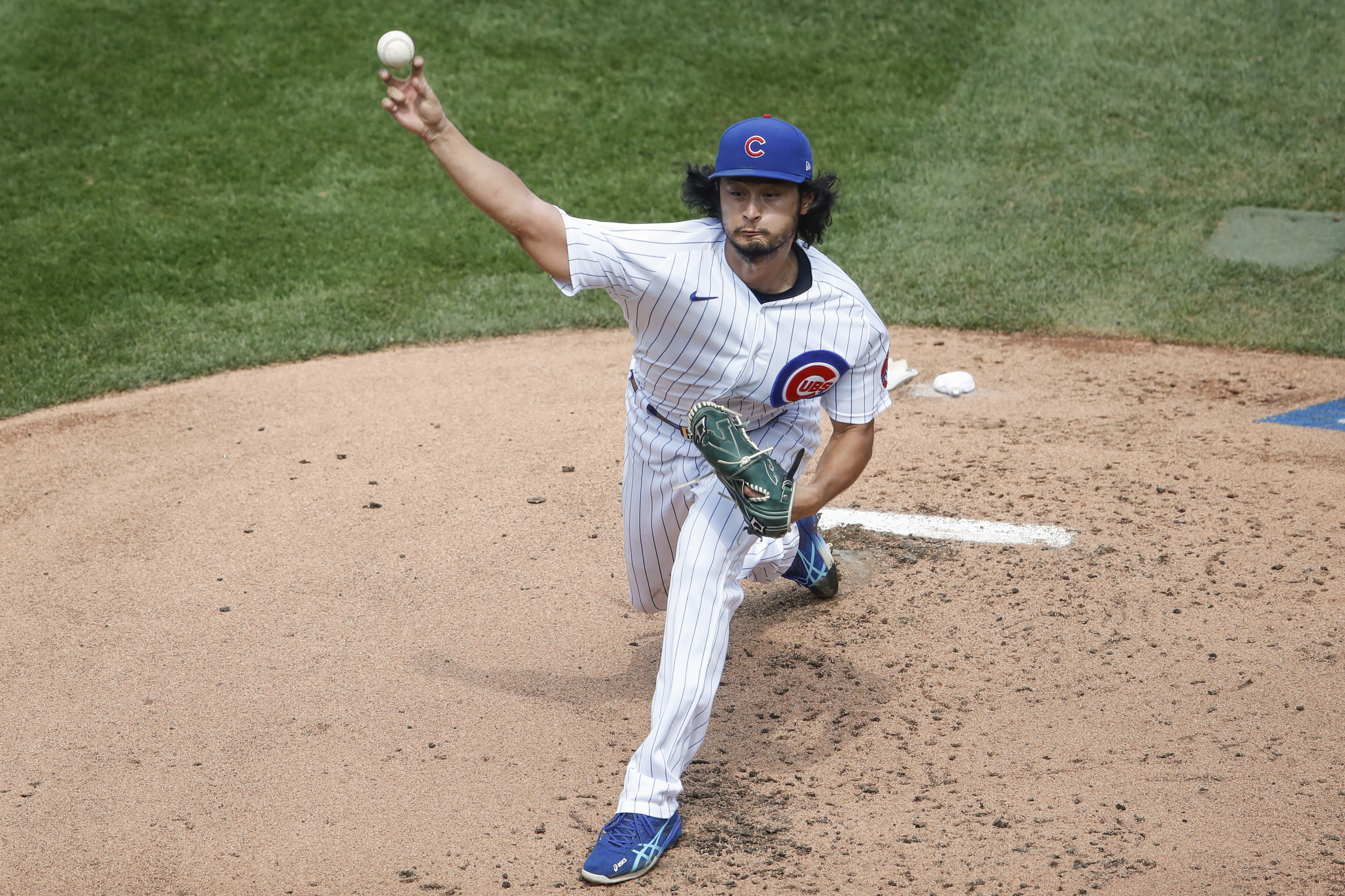 Chicago Cubs starting pitcher Yu Darvish delivers against the Chicago White Sox during the second inning of a baseball game, Sunday, Aug. 23, 2020, in Chicago. (AP Photo/Kamil Krzaczynski)