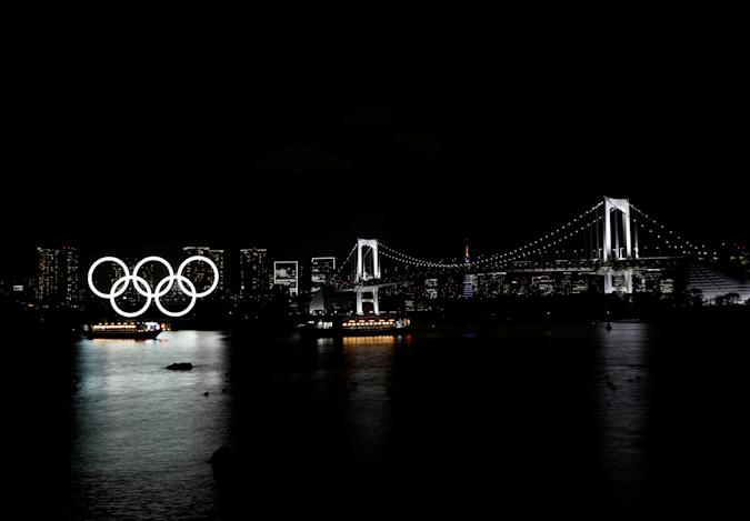 """Boats sail past the giant Olympic rings and the Rainbow Bridge on the waterfront area of Odaiba Marine Park in Tokyo, Japan, April 2, 2021. REUTERS/Kim Kyung-Hoon     SEARCH """"TOKYO POSTCARDS"""" FOR THIS STORY. SEARCH """"WIDER IMAGE"""" FOR ALL STORIES     TPX IMAGES OF THE DAY"""