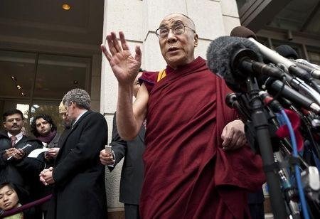 The Dalai Lama speaks to the media after meeting with U.S. President Obama and Clinton, U.S. Secretary of State, outside his hotel in Washington