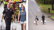 Woman with carload of groceries finds a closed road, officer carries bags a half mile to her home