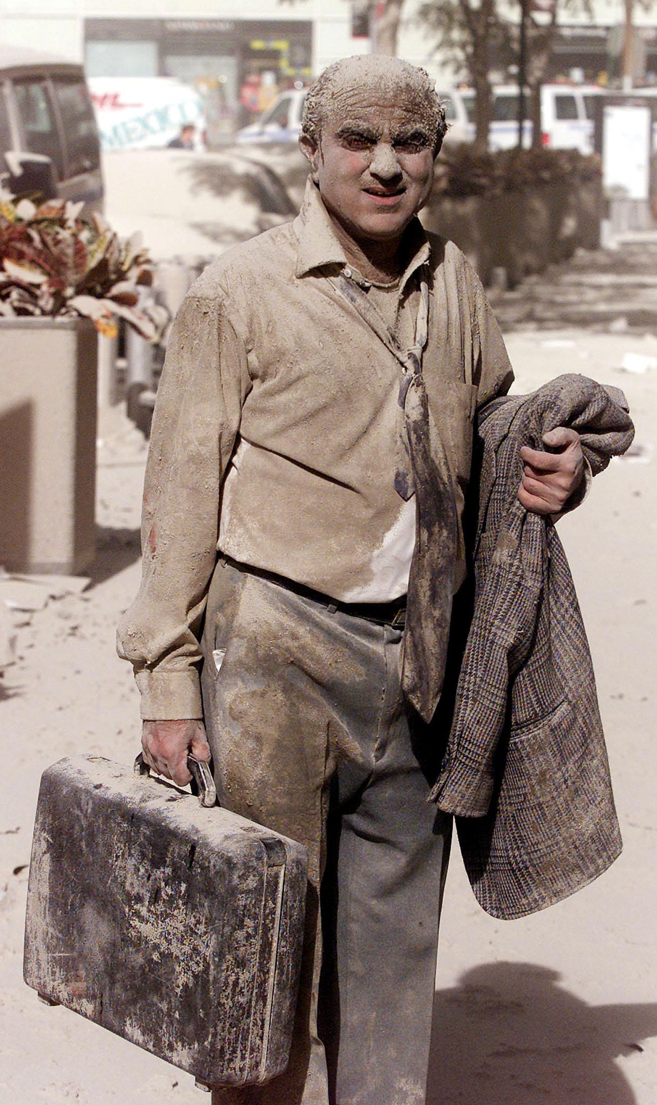 """A man covered in dust walks in the street near the site of the World Trade Center towers in New York City, in this file photo taken early September 11, 2001. This year's anniversary of the September 11 attacks in New York and Washington will echo the first one, with silence for the moments the planes struck and when the buildings fell, and the reading of 2,792 victims' names. <br><br>(REUTERS/Shannon Stapleton-Files HB)<br><br>For the full photo collection, go to <a href=""""http://www.life.com/gallery/59971/911-the-25-most-powerful-photos#index/0"""" rel=""""nofollow noopener"""" target=""""_blank"""" data-ylk=""""slk:LIFE.com"""" class=""""link rapid-noclick-resp"""">LIFE.com</a>"""