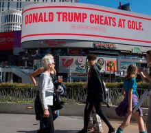 Mike Bloomberg is going after Trump with billboards mocking him for eating burnt steak and cheating at golf