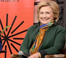Hillary Clinton says she still feels the urge to beat Trump
