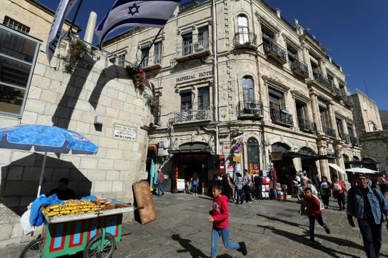 Image: The Imperial Hotel, next to the Jaffa Gate in Jerusalem, is at the centre of a years-long dispute between its Palestinian tenants and an Israeli settler organisation which allegedly secretly bought it in 2004 from the Greek Orthodox Church (AFP Photo/GALI TIBBON)