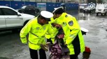 Local Police Assist Civilians in Flooded Lanzhou