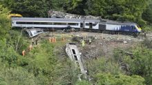 Three dead, including driver, after train derailment 'caused by landslip'