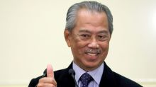 Pandemic, Malay power lend popularity boost to Malaysia PM: poll