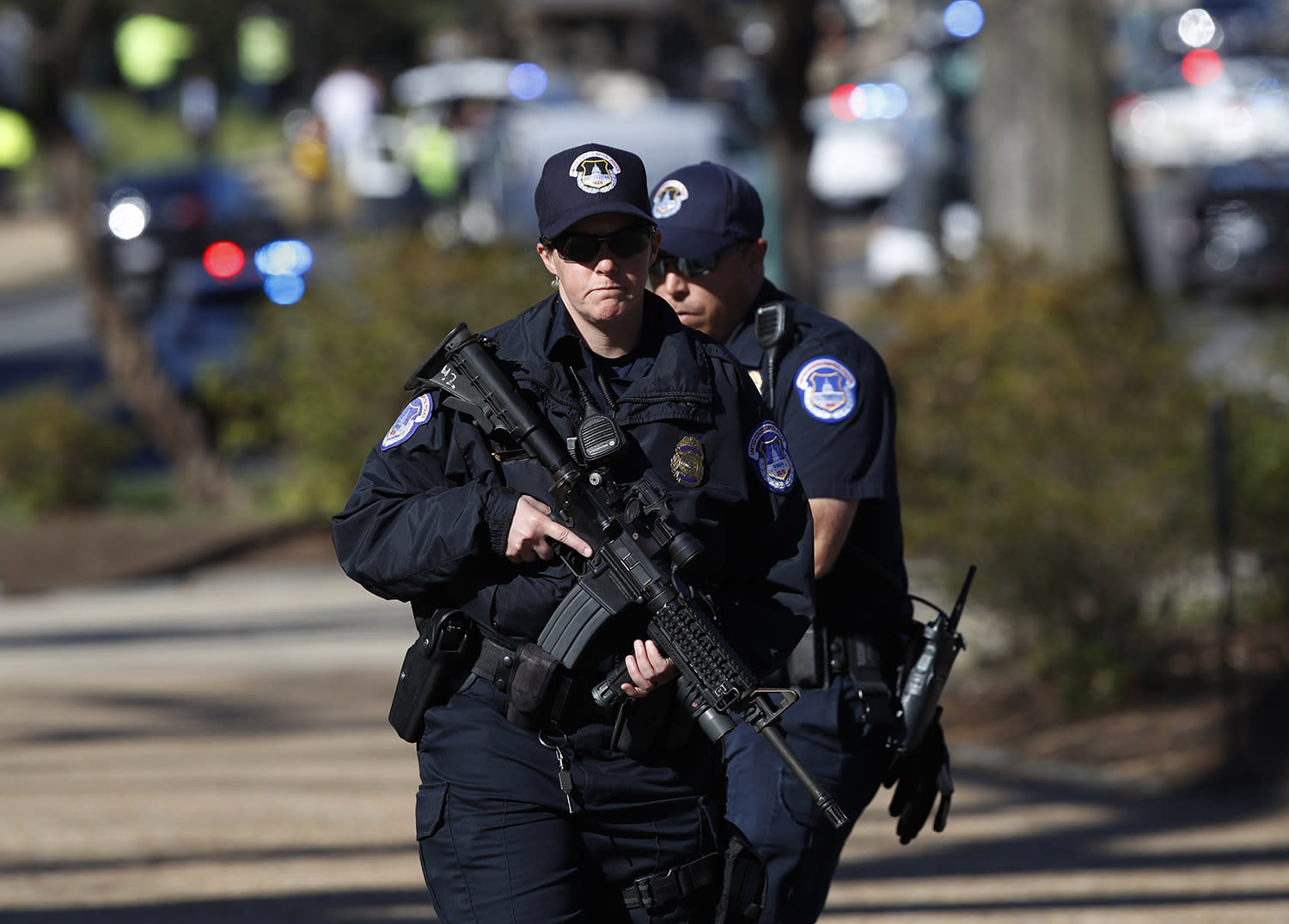 <p>Armed U.S. Capitol Police officers take position near the Botanic Gardens in Washington, Wednesday, March 29, 2017. A woman struck a U.S. Capitol Police cruiser with a vehicle near the Capitol on Wednesday morning and was taken into custody, police said. (AP Photo/Manuel Balce Ceneta) </p>