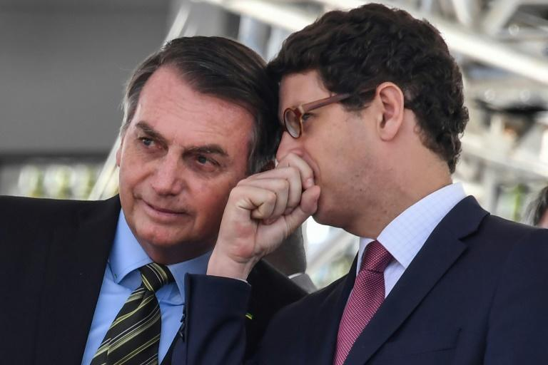 Brazilian President Jair Bolsonaro (L), with his Environment Minister Ricardo Salles in October 2019, has been widely criticized for easing restrictions on exploiting the Amazon's vast riches, leading to an acceleration in deforestation