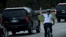 Cyclist who lost job for giving Trump motorcade the finger has no regrets