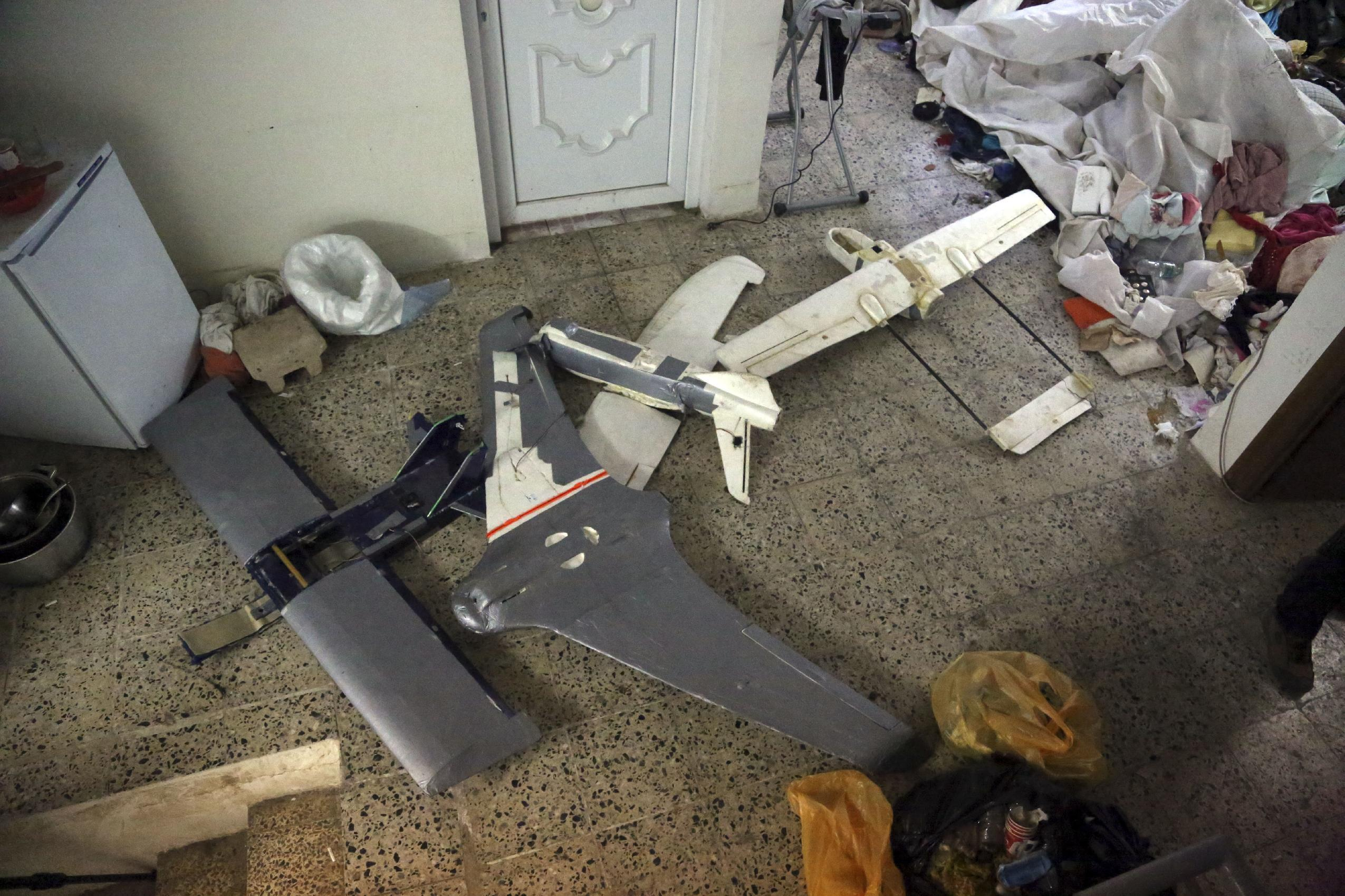 In this Friday, Jan. 27, 2017 photo, drones belonging to Islamic State militants in Mosul, Iraq. Islamic State is hacking store-bought drone technology, using rigorous testing and tactics that mimic those used by U.S. unmanned aircraft to adapt to diminishing numbers of fighters and a battlefield that is increasingly difficult to navigate on the ground. (AP Photo/ Khalid Mohammed)