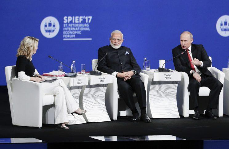 Russian President Vladimir Putin, right, Indiain Prime Minister Narendra Modi, center, and NBC journalist Megyn Kelly, left, attend the St. Petersburg International Economic Forum in St. Petersburg, Russia, Friday, June 2, 2017. (Photo: Dmitry Lovetsky/AP)