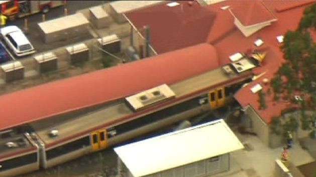 Train smashes into building
