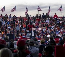 The Latest: Trump says he felt reluctant to hold rally
