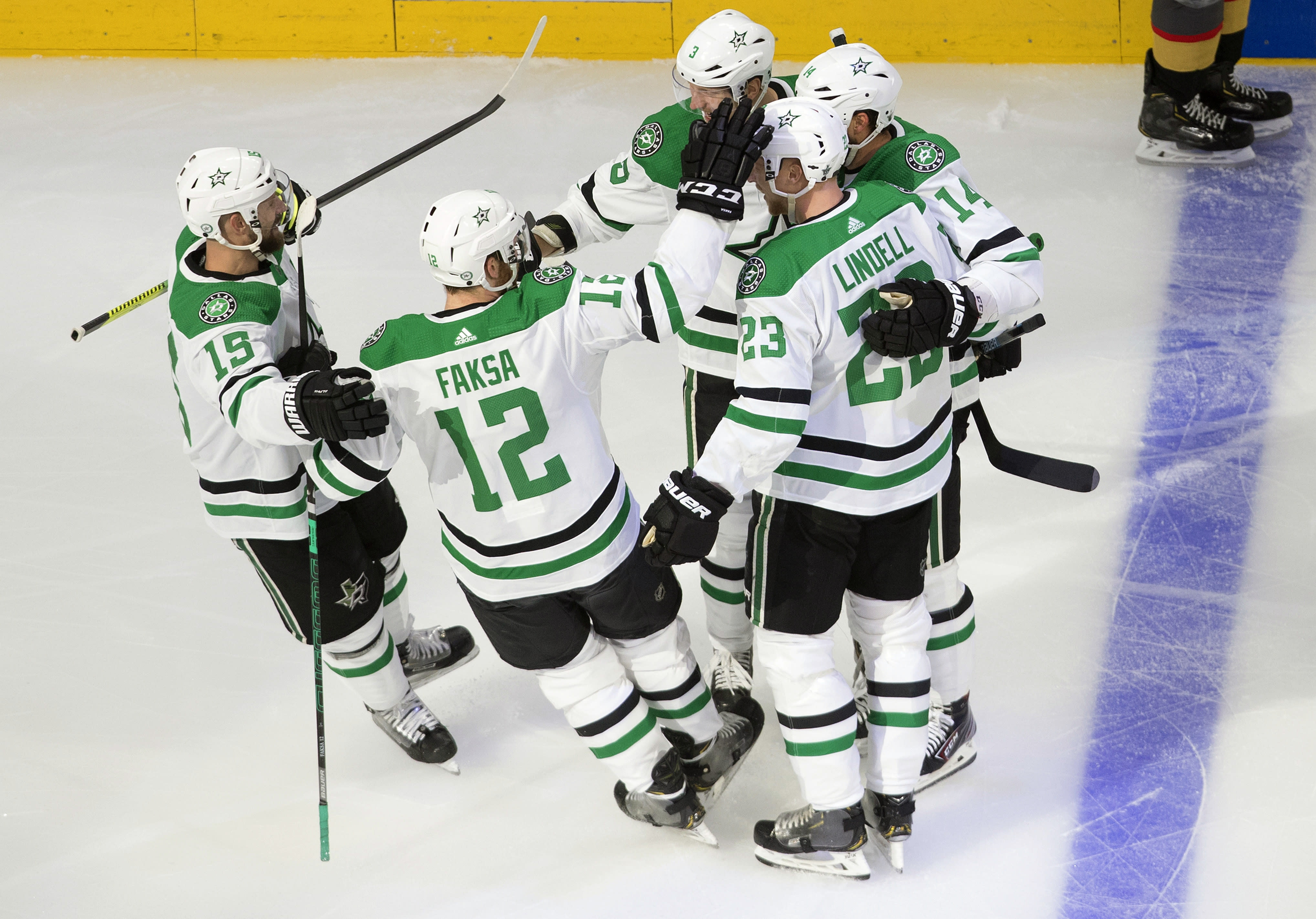 Dallas Stars' Blake Comeau (15), Radek Faksa (12), Esa Lindell (23), Jamie Benn (14) and John Klingberg (3) celebrate a goal by Klingberg against the Vegas Golden Knights during the first period of Game 1 of an NHL Western Conference final hockey game, Sunday, Sept. 6, 2020 in Edmonton, Alberta. (Jason Franson/The Canadian Press via AP)