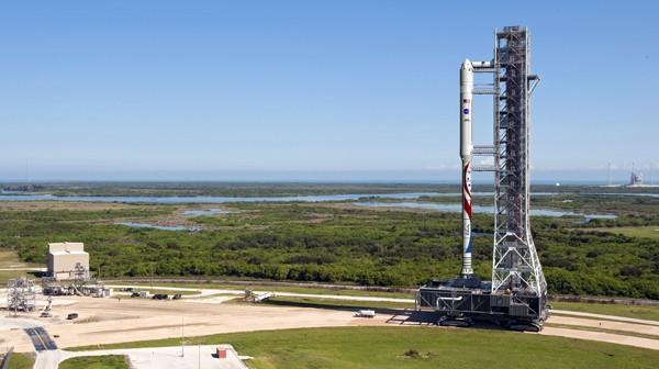 Dark horse set to ride into space race, strapped to world's largest solid rocket booster