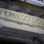 Wall Street rises on record job growth; surging virus cases cap gains