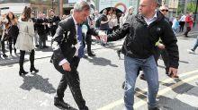 Nigel Farage doused in milkshake on the campaign trail
