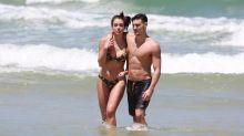 Bruno Montaleone, ex de Sasha Meneghel, curte praia com bailarina do Faustão