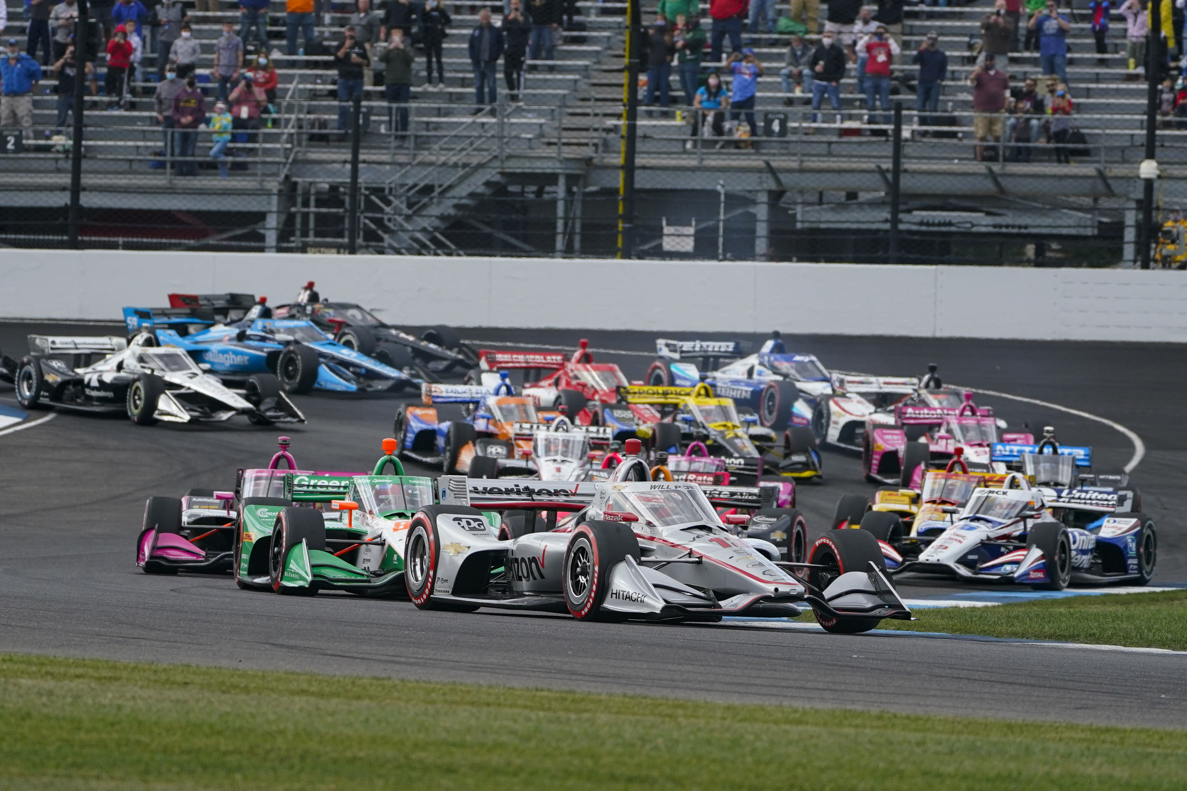 Will Power, of Australia, leads the first into the second turn on the start of an IndyCar auto race at Indianapolis Motor Speedway in Indianapolis, Saturday, Oct. 3, 2020. (AP Photo/Michael Conroy)