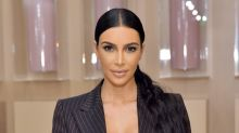 Kim Kardashian Is a Proud Daughter at Opening of Health Center Named After Late Father Robert