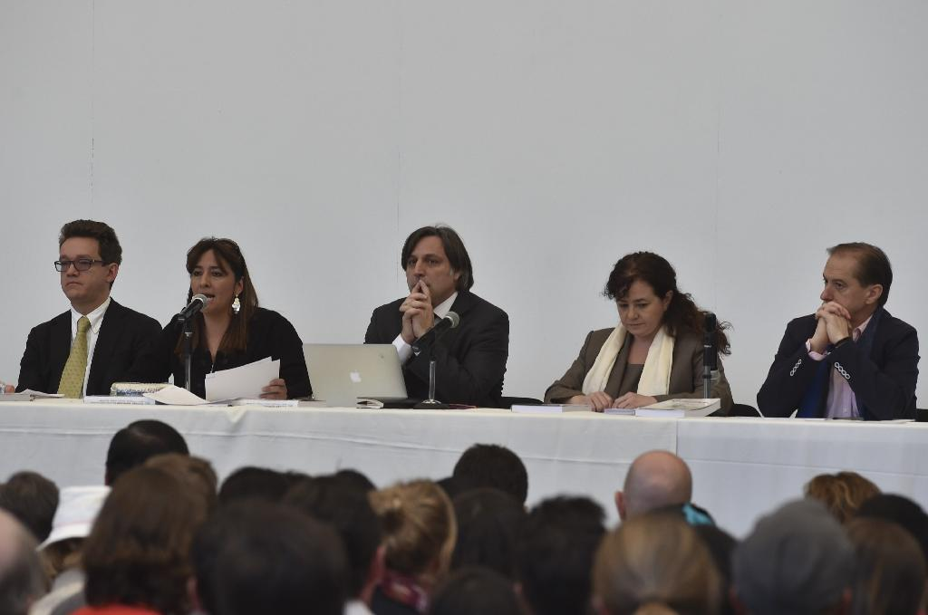 Members of Interdisciplinary Group of Independent Experts (GIEI) read their final report on the disappearance of 43 students from the Ayotzinapa teachers school, in Mexico City on April, 24, 2016 (AFP Photo/Yuri Cortez)