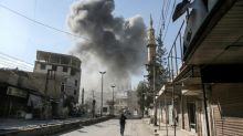 Merkel calls for end to 'massacre' in Syria