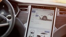 Does Tesla, Inc.'s (NASDAQ:TSLA) CEO Pay Compare Well With Peers?