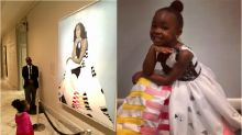 Little girl who admired Michelle Obama's portrait dresses as the former first lady for Halloween