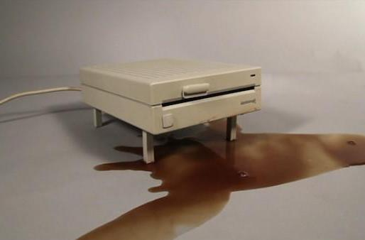 Floppy drive grows legs to avoid spills, still can't avoid extinction