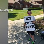 Police called on boy holding 'ice cold beer' sign
