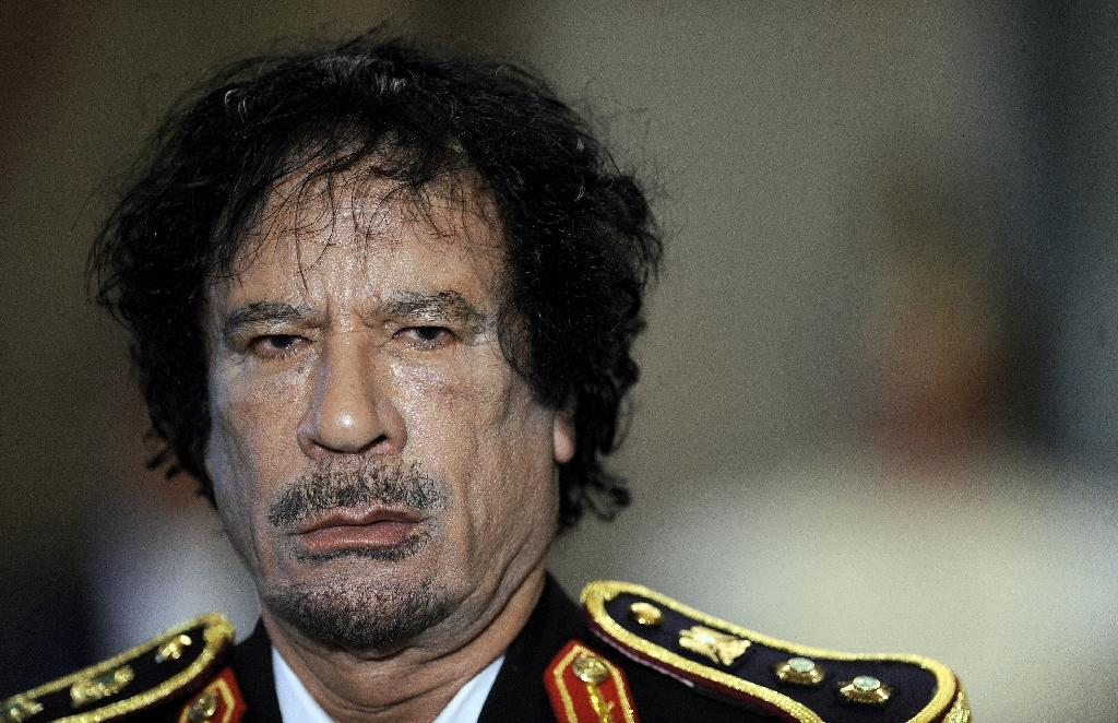 "Libya's Moamer Kadhafi unveiled his much-heralded ""third way"" seven years after he led a group of Libyan army officers in a 1969 coup d'etat that toppled the monarchy (AFP Photo/Filippo Monteforte)"