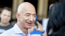 Jeff Bezos is this week's champ, and Theresa May is the chump