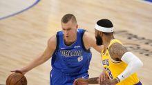 Kristaps Porzingis exits Mavericks game with left ankle sprain